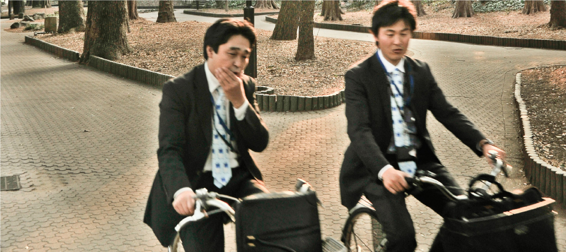 Businessmen conversing on bikes in Tokyo, Japan (photo: P.M. Lydon)