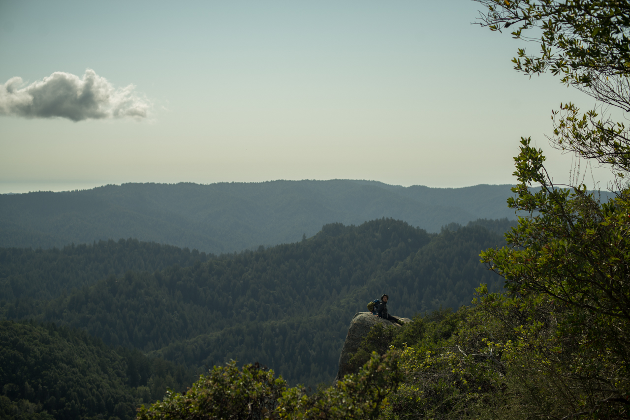 A hiker rests on the trail at Castle Rock State Park in the hills south of Silicon Valley | photo by P.M.Lydon