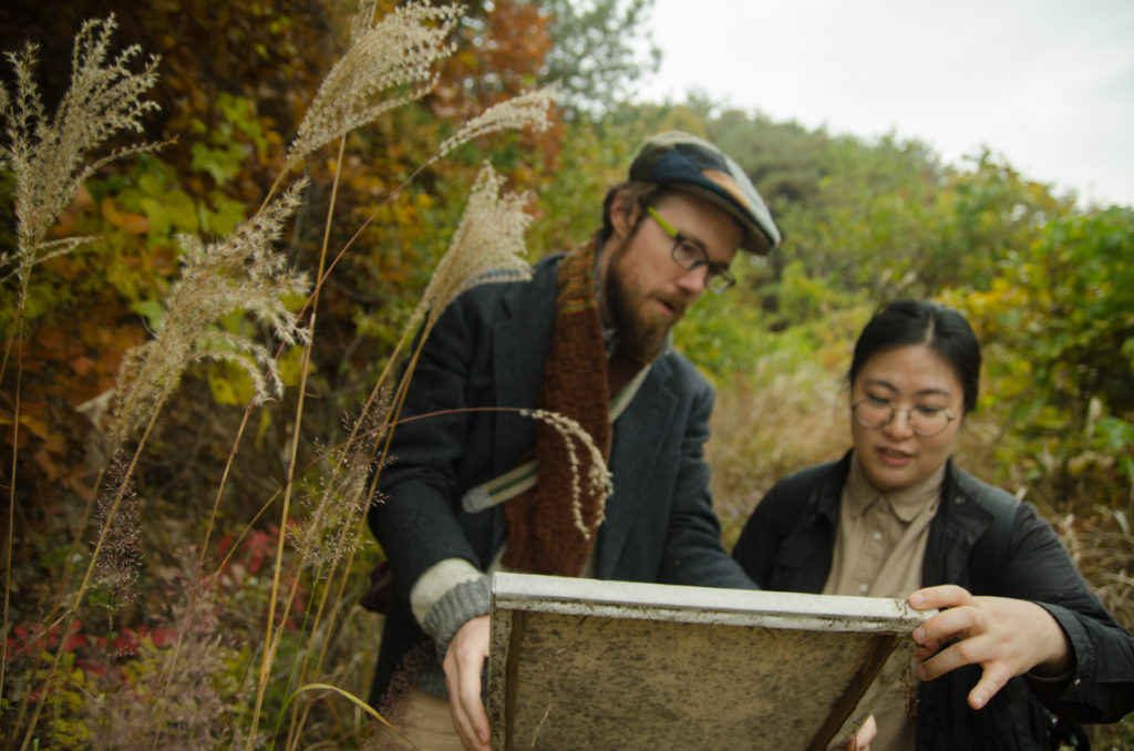 Patrick and Joohee inspect one of the canvases after the forest has finished its work.