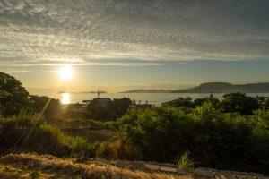 Mountain, farm, and a view of the Seto Inland Sea at sunrise from Megijima Island, Japan